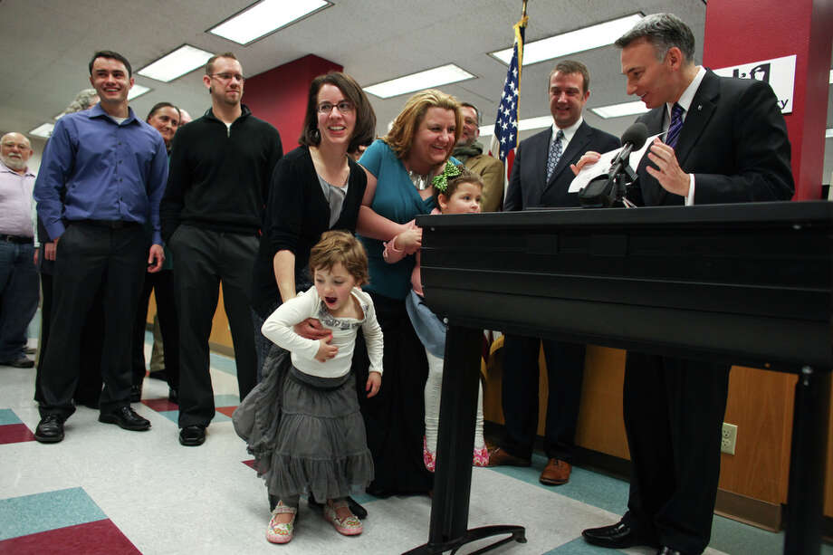 Parents Amanda Beane and Anne Bryson-Beane are given their marriage license by King County Executive Dow Constantine. Photo: JOSHUA TRUJILLO / SEATTLEPI.COM
