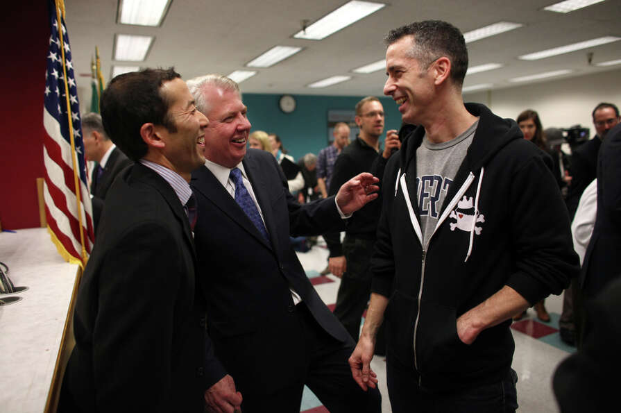 Michael Shiosaki, Senator Ed Murray and columnist Dan Savage share a laugh after Savage was issued a