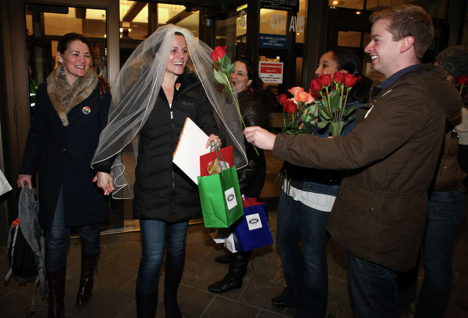 Jeri Andrews, left, and her partner of five years Amy Andrews walk out of the King County Administration Building with their marriage license. Photo: JOSHUA TRUJILLO / SEATTLEPI.COM