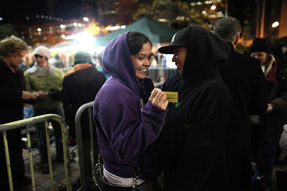 Kelly Middleton, 24, and her partner Amanda Dollente, 29, both of Auburn, are first in line as gay couples wait outside of the King County Administration Building. Photo: JOSHUA TRUJILLO / SEATTLEPI.COM