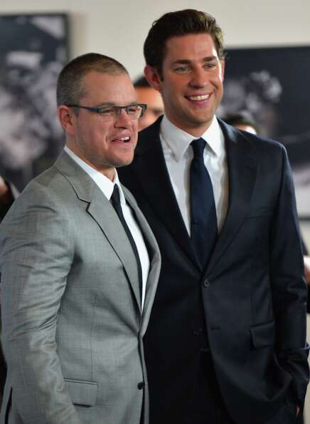 Actors Matt Damon and John Krasinski arrive to the premiere of Focus Features' Promised Land at the