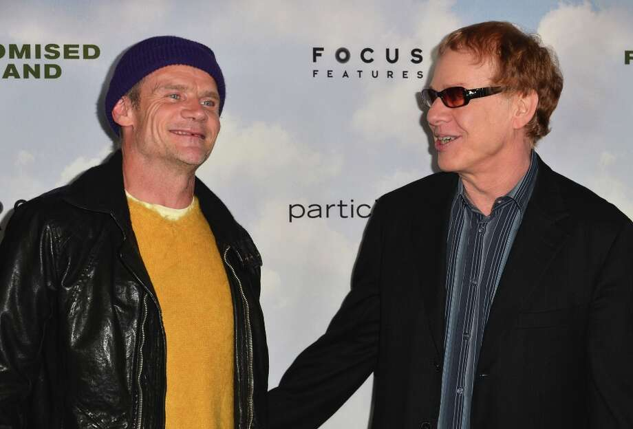 Musician Flea of The Red Hot Chili Pepers and Composer Danny Elfman arrives to the premiere of Focus Features' Promised Land at the Directors Guild Of America on December 6, 2012 in Los Angeles, California. Photo: Alberto E. Rodriguez, Getty Images / 2012 Getty Images