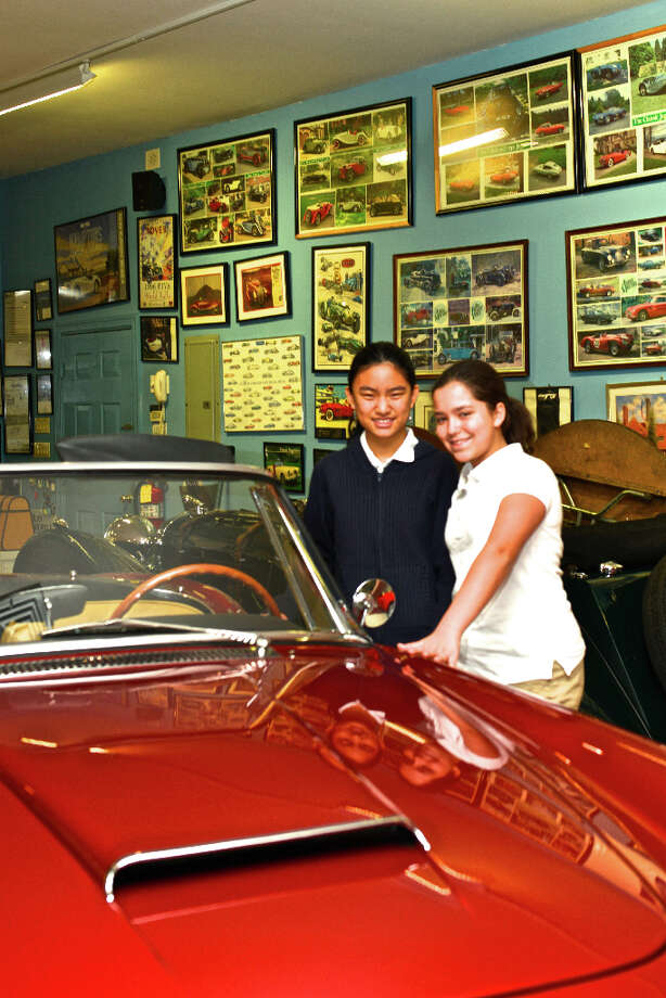 Vintage car collector, Malcolm Pray of Greenwich gives a tour of his Pray Automotive Museum located in Banksville, N.Y. to fellow supporters of the Manhattan Christian Academy on December 1, 2012.