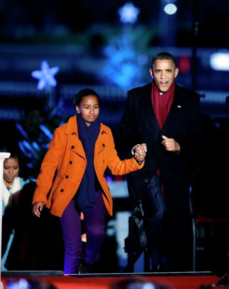 President Barack Obama, arrives with daughter Sasha Obama for the 90th annual National Christmas Tre