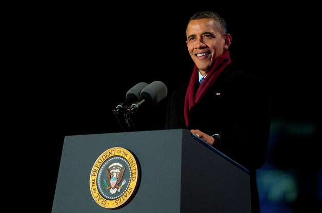President Barack Obama speaks at the annual National Christmas Tree Lighting on the Ellipse, Thursday, Dec. 6, 2012, in Washington. This year's giant blue spruce is new, transplanted in October on the Ellipse, south of the White House. (Carolyn Kaster / AP Photo) Photo: Carolyn Kaster, Associated Press / AP