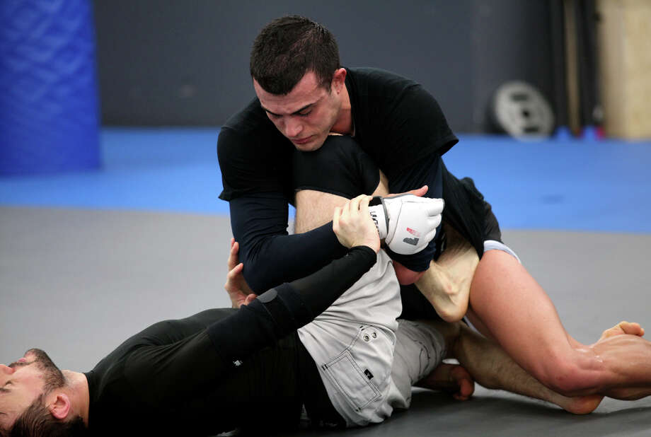 Nick Newell, top,  of Trumbull, trains at Ultimate MMA Gym in NorthHaven, Conn. on Monday, December 3, 2012. Newell competed for the mixed martial arts XFC extreme fighting championship lightweight title on Friday Dec. 7th in Nashville, TN. Photo: BK Angeletti, B.K. Angeletti / Connecticut Post freelance B.K. Angeletti