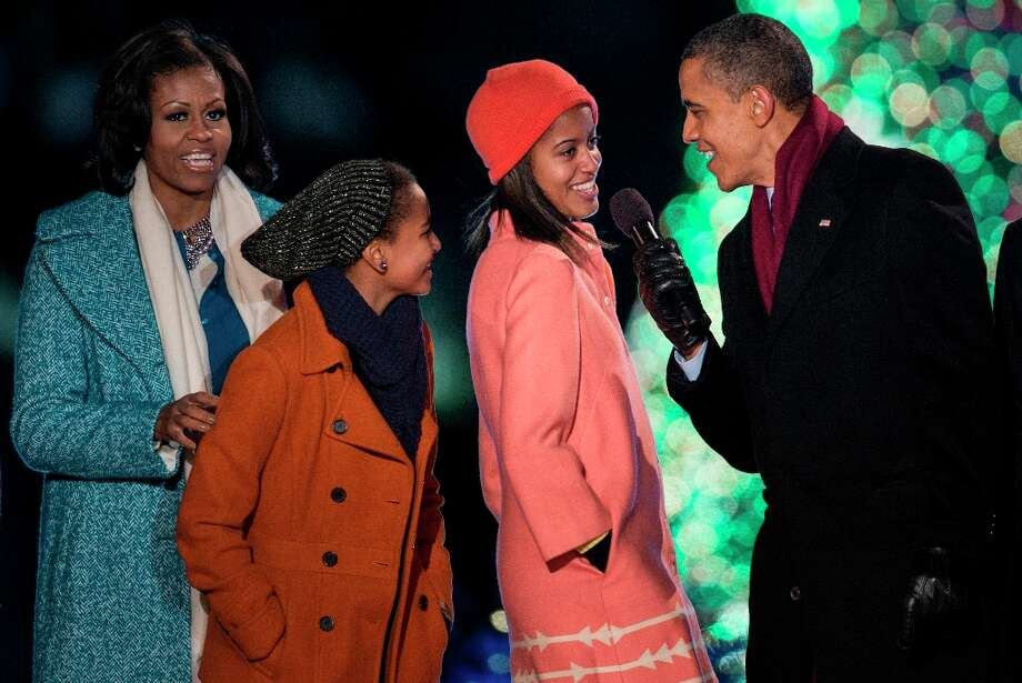 US First Lady Michelle Obama, daughters Sasha and Malia Obama and US President Barack Obama sing Santa Clause is Coming to Town during the 90th annual National Christmas Tree Lighting on the Ellipse of the National Mall December 6, 2012 in Washington, DC. Obama and others attended the event which included entertainment before the lighting of the National Christmas Tree. (Brendan Smialowski / Getty Images) Photo: BRENDAN SMIALOWSKI, AFP/Getty Images / 2012 Brendan Smialowski