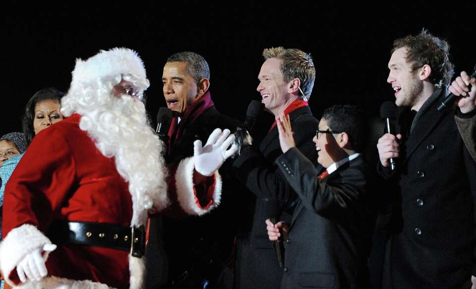 (L-R) Santa Claus joins U.S. President Barack Obama with actor Neil Patrick Harris, Rico Rodriguez,