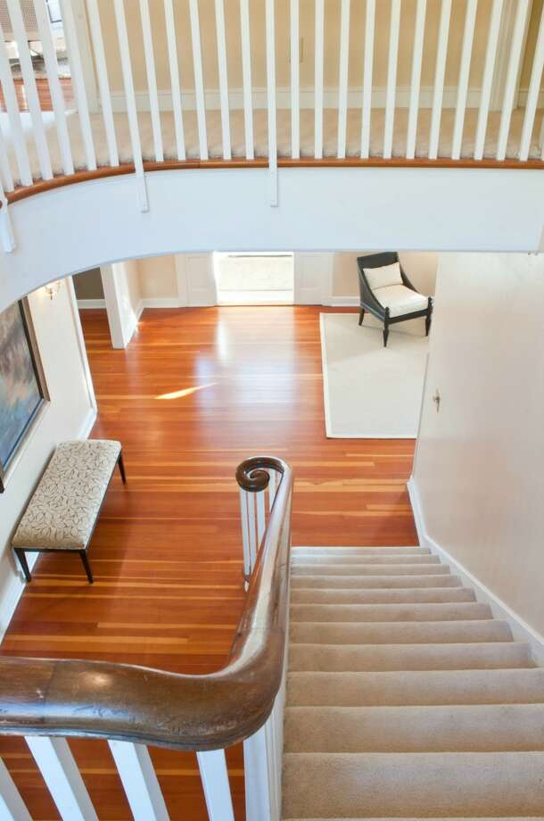 Stairway of the Admiral's House, 2001 W. Garfield St., in Magnolia. The 7,316-square-foot house, built by the U.S. Navy in 1944, has eight bedrooms and 4.25 bathrooms, on 3.89 acres with dramatic views of downtown Seattle and Puget Sound. It's listed for $3.2 million. Photo: Matt Flor/Courtesy Staci Baldwin, Cooper Jacobs Real Estate