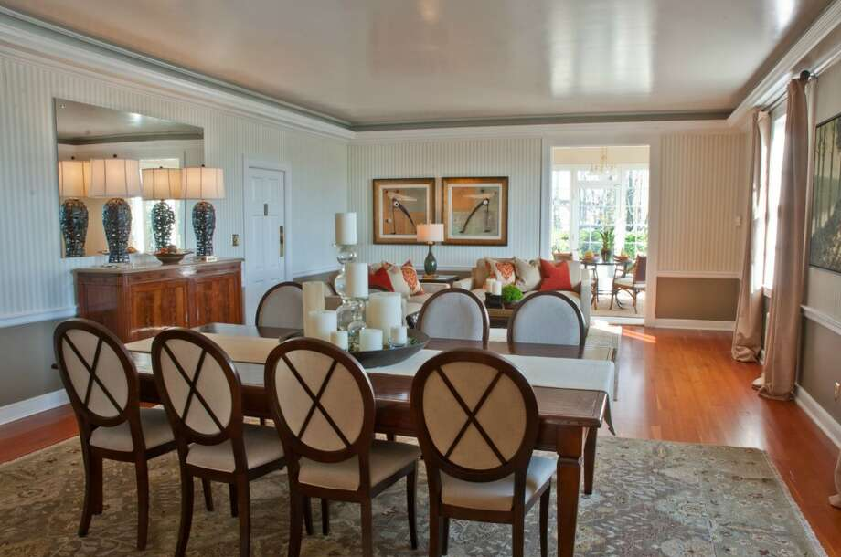Living and dining room of the Admiral's House, 2001 W. Garfield St., in Magnolia. The 7,316-square-foot house, built by the U.S. Navy in 1944, has eight bedrooms and 4.25 bathrooms, on 3.89 acres with dramatic views of downtown Seattle and Puget Sound. It's listed for $3.2 million. Photo: Matt Flor/Courtesy Staci Baldwin, Cooper Jacobs Real Estate