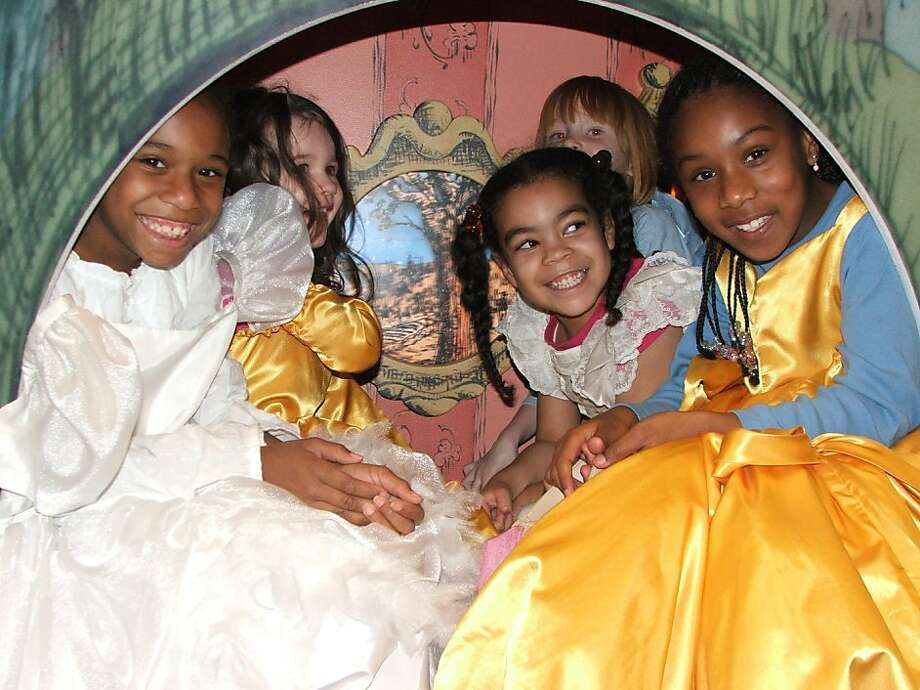 "Girls in princess dresses enjoy the Cinderella carriage in the ""Once Upon a Time"" exhibit, which will open Saturday. Photo: Courtesy Of The Museum"