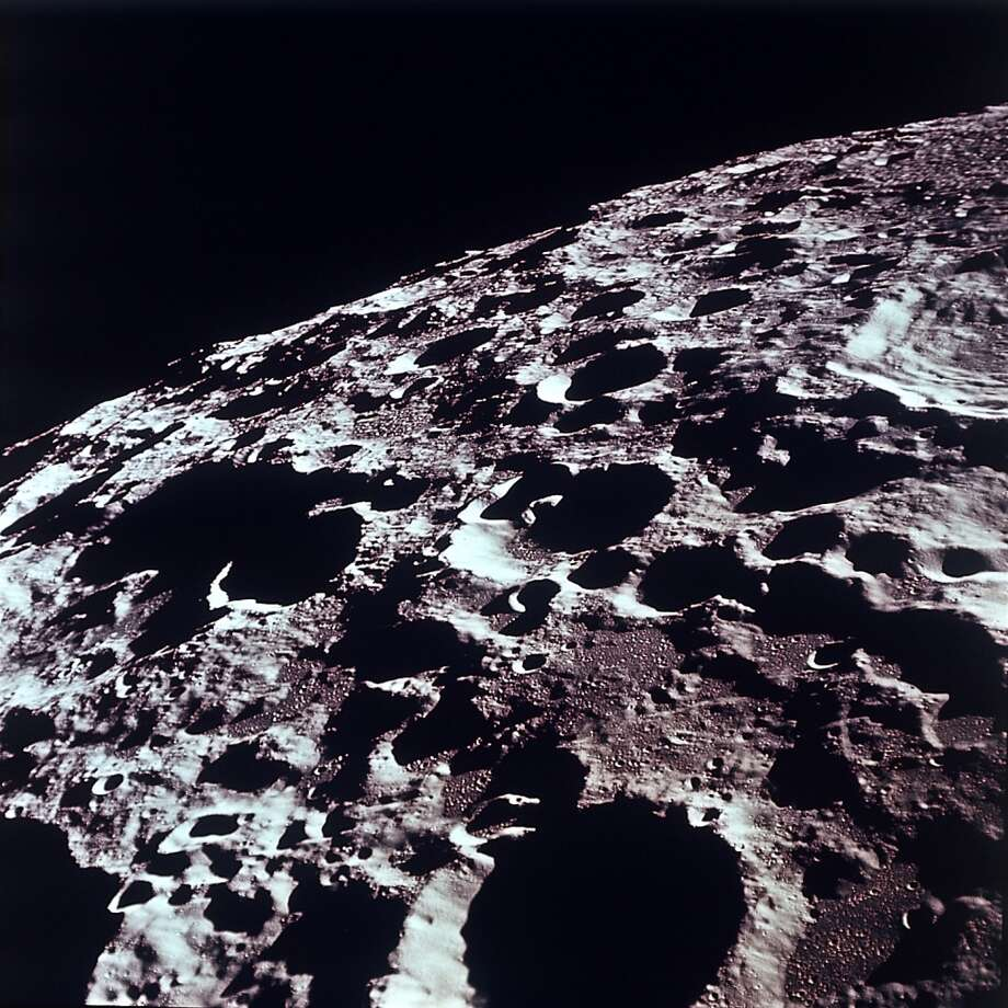 This photo, released by NASA July 20, 1969, shows an Apollo 11 southeasterly view of the lunar far side. International Astronomical Union crater no. 308 is at the bottom of the photo. This crater is about 58 miles in diamter.  Near the center of the photograph, a small apex crater (less than one statute mile in diameter) rests on a nearby conical shaped hill, which is on the  common rim of two adjacent unnamed large craters (about 20 and 9 miles in diameter respectively). (AP photo/NASA) (ASSOCIATED PRESS)
