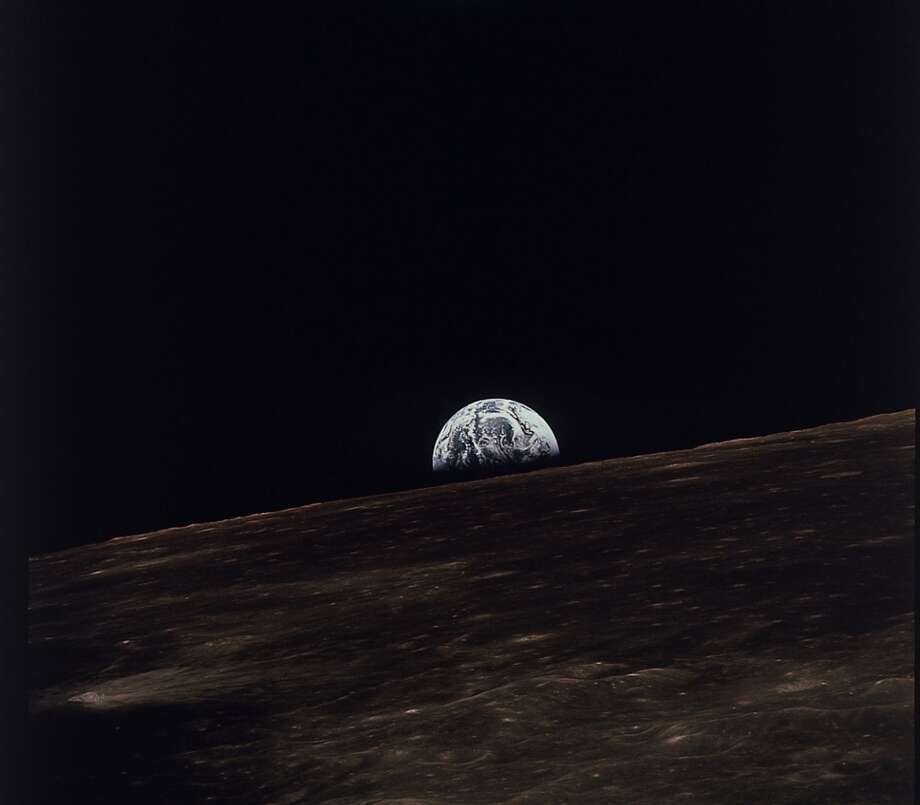 The earth is shown rising above the moon's horizon as seen from the Apollo 11 spacecraft, July, 1969.  (AP photo/NASA) (ASSOCIATED PRESS)