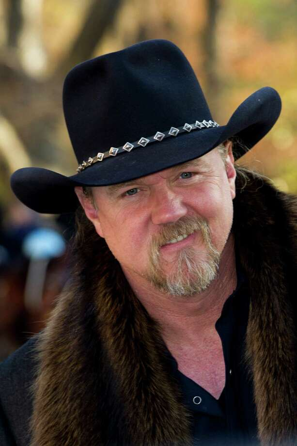 FILE - In this Thurs., Nov. 22, 2012 file photo,Trace Adkins arrives to the Macy's Thanksgiving Day Parade in New York. Trace Adkins wore an earpiece decorated like the Confederate flag when he performed for the Rockefeller Center Tree Lighting on Nov. 28, but he said he didn't mean to offend anyone by wearing it. (AP Photo/Charles Syke, File) Photo: Charles Sykes, FRE / AP