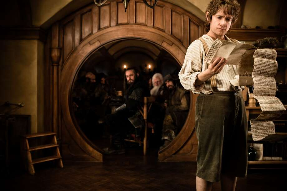 (Background l-r) GRAHAM McTAVISH as Dwalin, WILLIAM KIRCHER as Bifur, RICHARD ARMITAGE as Thorin Oakenshield, KEN STOTT as Balin, JAMES NESBITT as Bofur, and MARTIN FREEMAN (far right) as Bilbo Baggins in the fantasy adventure œTHE HOBBIT: AN UNEXPECTED JOURNEY, a production of New Line Cinema and Metro-Goldwyn-Mayer Pictures (MGM), released by Warner Bros. Pictures and MGM.