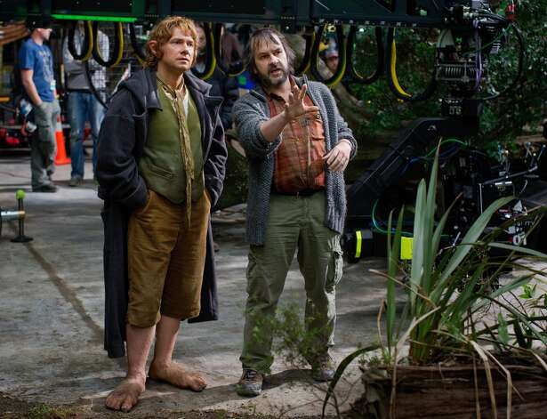 (L-r) MARTIN FREEMAN and director PETER JACKSON on the set of the fantasy adventure THE HOBBIT: AN UNEXPECTED JOURNEY, a production of New Line Cinema and Metro-Goldwyn-Mayer Pictures (MGM), released by Warner Bros. Pictures and MGM.