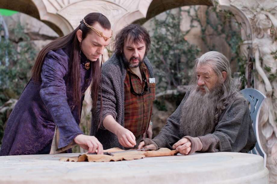 (L-r) HUGO WEAVING, director PETER JACKSON and IAN McKELLEN on the set of the fantasy adventure THE HOBBIT: AN UNEXPECTED JOURNEY, a production of New Line Cinema and Metro-Goldwyn-Mayer Pictures (MGM), released by Warner Bros. Pictures and MGM.