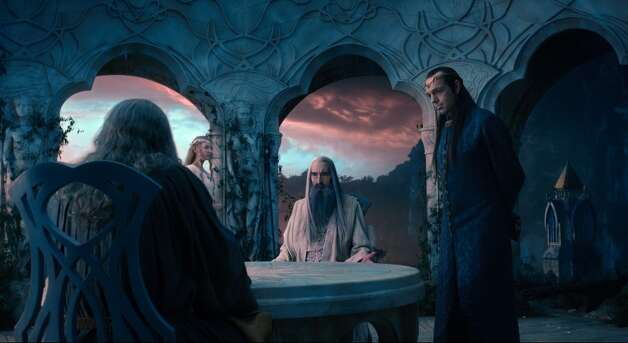 (L-r) CATE BLANCHETT as Galadriel, CHRISTOPHER LEE as Saruman and HUGO WEAVING as Elrond in the fantasy adventure THE HOBBIT: AN UNEXPECTED JOURNEY,€ a production of New Line Cinema and Metro-Goldwyn-Mayer Pictures (MGM), released by Warner Bros. Pictures and MGM.