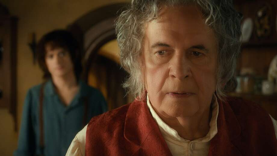 (L-r) ELIJAH WOOD as Frodo and IAN HOLM as Bilbo Baggins in the fantasy adventure THE HOBBIT: AN UNEXPECTED JOURNEY, a production of New Line Cinema and Metro-Goldwyn-Mayer Pictures (MGM), released by Warner Bros. Pictures and MGM.