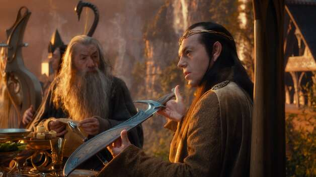 (L-r) IAN McKELLEN as Gandalf and HUGO WEAVING as the Elf Lord Elrond in the fantasy adventure THE HOBBIT: AN UNEXPECTED JOURNEY, a production of New Line Cinema and Metro-Goldwyn-Mayer Pictures (MGM), released by Warner Bros. Pictures and MGM.