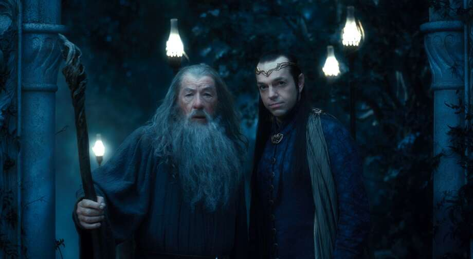 (L-r) IAN McKELLEN as Gandalf and HUGO WEAVING as Elrond in the fantasy adventure THE HOBBIT: AN UNEXPECTED JOURNEY, a production of New Line Cinema and Metro-Goldwyn-Mayer Pictures (MGM), released by Warner Bros. Pictures and MGM.