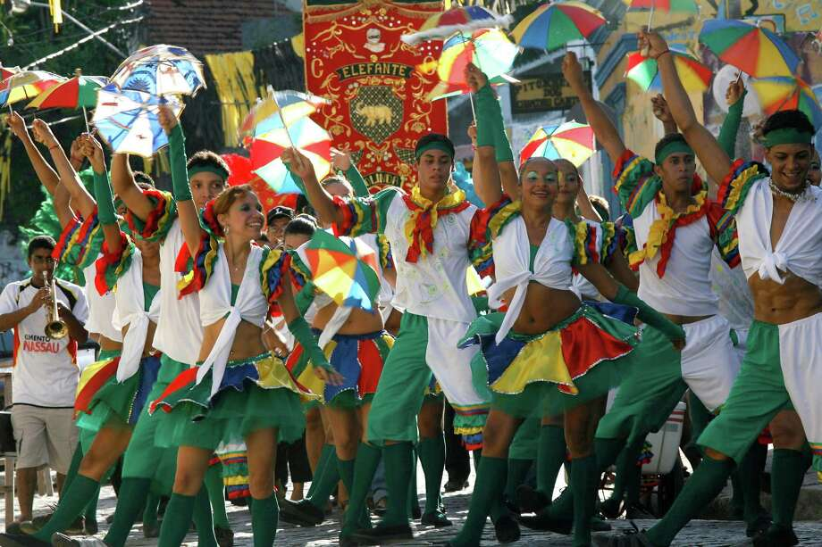 Members of the Bloco de Frevo group perform during a carnival parade in Olinda, in Brazil's northern Pernambuco state, Jan. 25, 2008. Frevo, the most popular rhythm of Pernambuco's carnival, turns 100 yeas and the Mangueira group, one of Brazil's best loved samba groups, will present a mix of samba and frevo during the Rio de Janeiro's carnival. (AP Photo/Eraldo Peres) Photo: Eraldo Peres, STR / AP