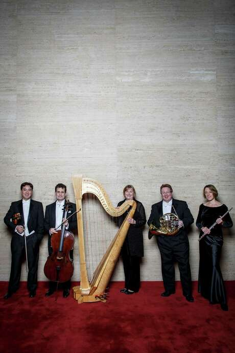 Houston Symphony musicians Frank Huang (violin), left to right, Brinton Averil-Smith (cello), Paula Page (harp), William VerMeulen (french horn), and Aralee Dorough (flute) pose for a photo, Wednesday, Dec. 5, 2012, in Houston. ( Michael Paulsen / Houston Chronicle ) Photo: Michael Paulsen, Staff / © 2012 Houston Chronicle