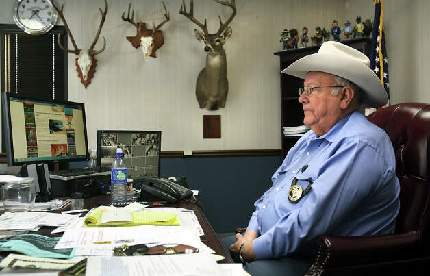Maverick County Sheriff Tomas Herrera sits at his desk in his office, where he is counting the days he has left as County Sheriff.  Herrera lost the possition in the last elections in Eagle Pass, Thursday, Nov. 29, 2012. Rudy Heredia, Commissioner of Precinct 2, and several county employees have been indicted for misuse of grant funds, among other charges. Photo: Bob Owen, San Antonio Express-News / © 2012 San Antonio Express-News