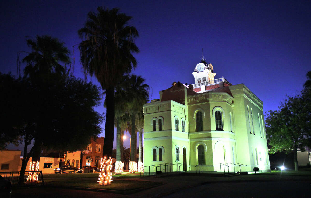 The holiday decorations at the old Maverick County Courthouse in Eagle Pass present a cheerier picture than do the county's financial books, which show it's $24 million in debt.