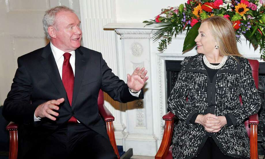 U.S. Secretary of State Hillary Rodham Clinton,  meets with Northern Ireland's  Deputy First Minister Martin McGuinness, left, at Stormont Castle in Belfast, Northern Ireland, Friday,  Dec. 7, 2012. Clinton travelled to Northern Ireland on Friday to lend her support to the British province's fragile peace, the frailty of which was underlined by overnight rioting on the eve of her visit and the seizure of a bomb. (AP Photo, Kevin Lamarque, Pool) Photo: KEVIN LAMARQUE, POOL / POOL REUTERS