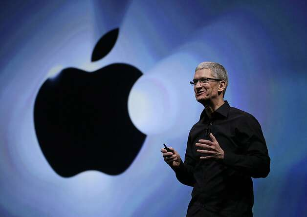 FILE - In this Wednesday, Sept. 12, 2012, file photo, Apple CEO Tim Cook speaks following an introduction of the new iPhone 5 in San Francisco. Apple is emerging as a gentler, cuddlier corporate citizen in the year after the death of CEO and co-founder Steve Jobs. CEO Tim Cook's announcement that the company is moving a Mac production line to the U.S. is just the latest step in a charm offensive designed to soften Apple's image. (AP Photo/Eric Risberg) Photo: Eric Risberg, Associated Press