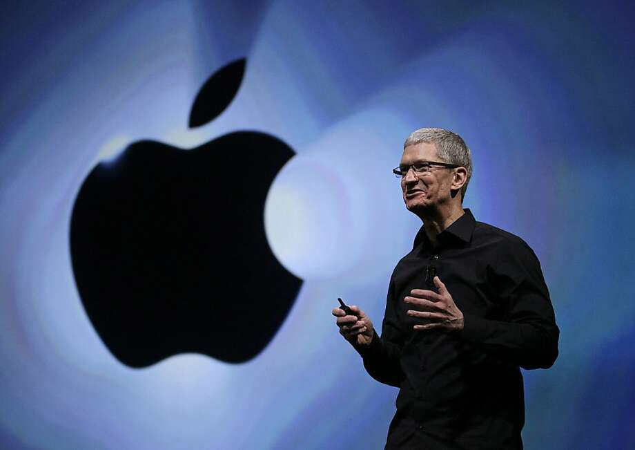 Apple CEO Tim Cook introduces the iPhone 5 in San Francisco in September. His pay includes $1.36 million in salary and $2.8 million in incentive-plan compensation for the fiscal year. Photo: Eric Risberg, Associated Press