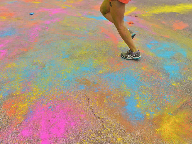 Because runners may not want to keep slogging through colored powder or mud piles,  race organizers are always dreaming up  new themes. Photo: Robin Jerstad, For The Express-News