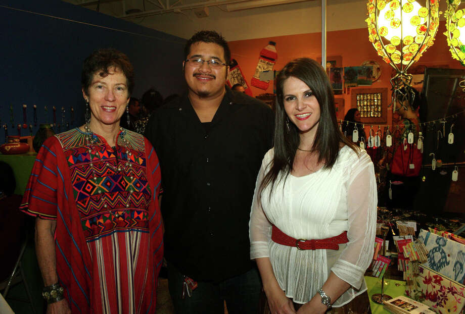 Artists Dale Jenssen, from left, Luis Hurtado and Karen Moca gather at  the reception for Hecho a Mano at the Guadalupe Cultural Arts Gallery. Photo: Leland A. Outz, For The Express-News / SAN ANTONIO EXPRESS-NEWS