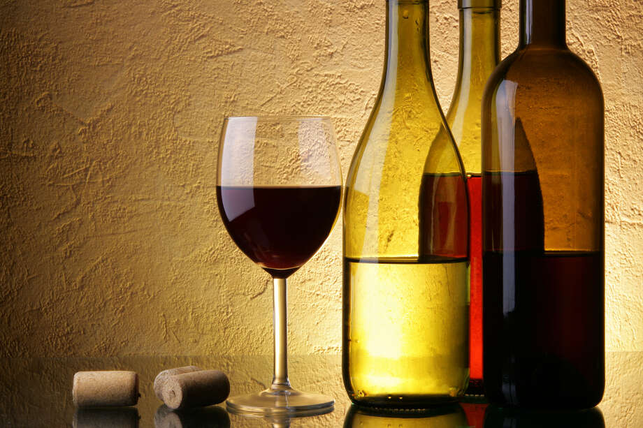Guzzling alcohol can raise LDL cholesterol and women's risk for breast cancer. Photo: Roman Sigaev / 6224511