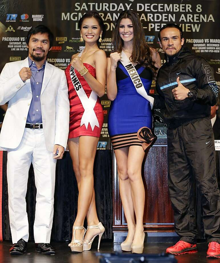 Manny Pacquiao (left) and Juan Manuel Marquez with Miss Universe contestants Janine Tugonon (Philippines) and Karina Gonzalez (Mexico). Photo: Julie Jacobson, Associated Press