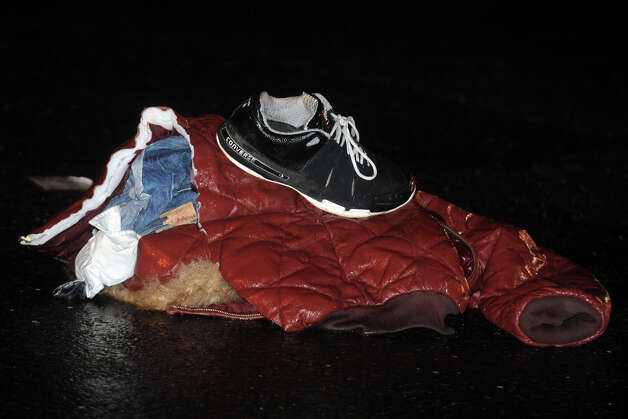 Items of clothing at the scene on Boston Ave. where three pedestrians were struck by a pickup truck late Friday evening, Dec. 7th, 2012, in Bridgeport, Conn. Photo: Ned Gerard / Connecticut Post