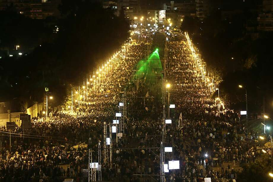 Demonstrators fill an area outside the presidential palace as they call for Morsi to step down. Photo: Hassan Ammar, Associated Press