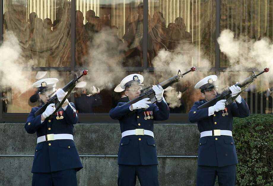 A rifle volley pays tribute to those killed in the Pearl Harbor attack during a memorial ceremony at the Coast Guard base in Alameda. Photo: Michael Macor, The Chronicle