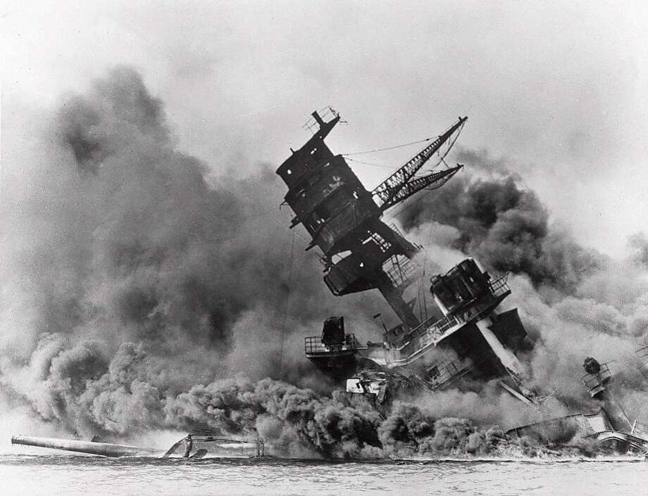 FILE - In this Dec. 7, 1941 file photo, smoke rises from the battleship USS Arizona as it sinks during a Japanese surprise attack on Pearl Harbor, Hawaii. (AP File Photo) Photo: Associated Press
