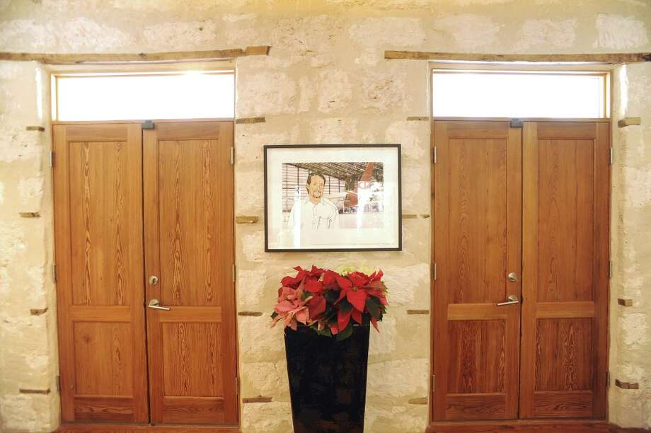 A portrait of Jerry Gore hangs by the double-door entryway into the home of Jerry and Samantha Gore. (Billy Calzada / San Antonio Express-News)
