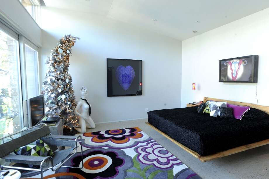 The master bedroom in the home of Jerry and Samantha Gore. (Billy Calzada / San Antonio Express-News)