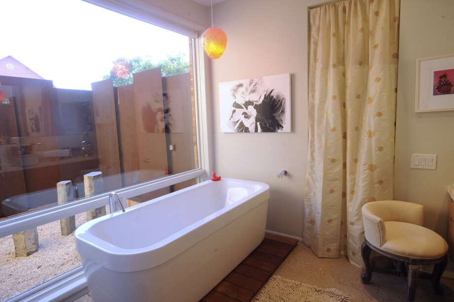 The bathroom in the home of Jerry and Samantha Gore. (Billy Calzada / San Antonio Express-News)