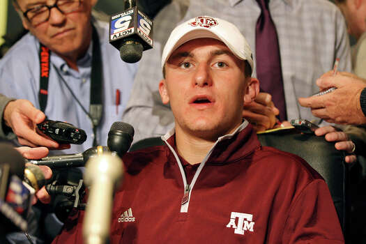Heisman finalist Texas A&M's quarterback Johnny Manziel answers questions from the media during a press conference Friday Dec. 7, 2012 at the New York Marriott Marquis hotel in New York, New York. Photo: Edward A. Ornelas, Express-News / © 2012 San Antonio Express-News
