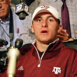 Heisman finalist Texas A&M's quarterback Johnny Manziel answers questions from the media during a press conference Friday Dec. 7, 2012 at the New York Marriott Marquis hotel in New York, New York.