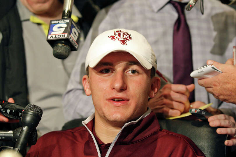 Heisman finalist Texas A&M's quarterback Johnny Manziel answers questions from the media during a pr