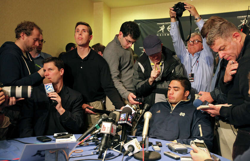 Heisman finalists Notre Dame's linebacker Manti Te'o (center right) answers questions from the media