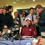 Heisman finalist Texas A&M's quarterback Johnny Manziel (center) answers questions from the media during a press conference Friday Dec. 7, 2012 at the New York Marriott Marquis hotel in New York, New York.