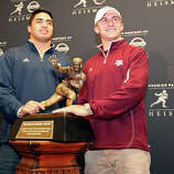 Heisman finalists Notre Dame's linebacker Manti Te'o (left) and Texas A&M's quarterback Johnny Manziel pose with the Heisman Trophy answer questions from the media during a press conference Friday Dec. 7, 2012 at the New York Marriott Marquis hotel in New York, New York. Not pictured is Heisman finalist Kansas State's quarterback Collin Klein.