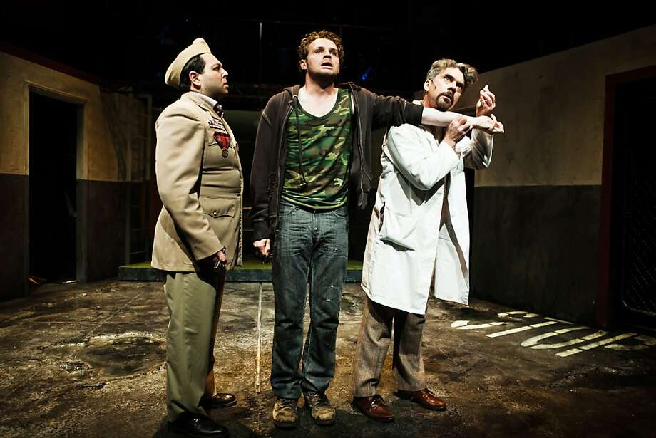 Alex Crowther as title character Woyzeck undergoes a medical experiment by Anthony Nemirovsky (left) and Kevin Clarke. Photo: Jessica Palopoli